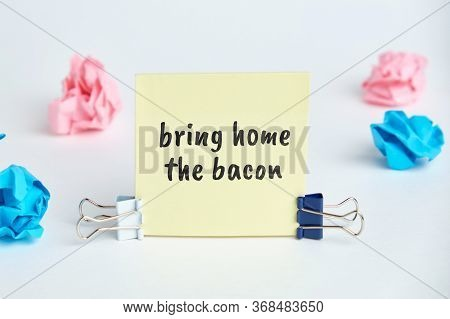 Bring Home The Bacon - English Time Idiom Hand Lettering On Wooden Blocks.
