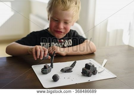 Child Sculpting Toy From Modelling Clay And Playing At Home