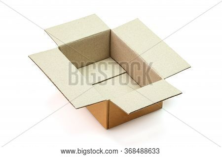 Cardboard Box Opened Empty Isolated On White Background. The Orange Parcel Cardboard Box For Package
