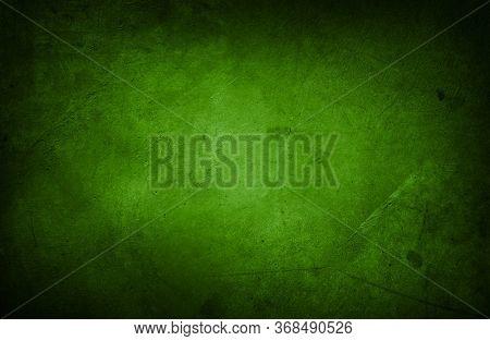 Closeup of green grungy textured wall. Dark edges