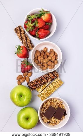 Bowls With Granola Or Muesli Bowl With Strawberry And Almond Muesli Bars Blue Background Healthy Die
