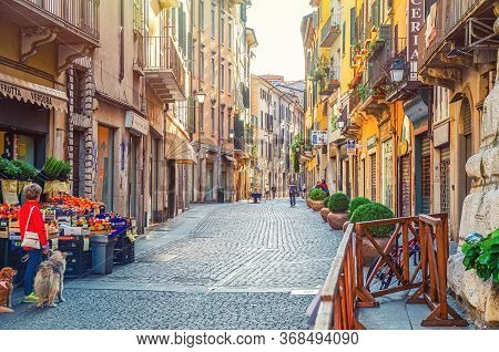 Brescia, Italy, September 11, 2019: Typical Italian Narrow Street With Traditional Old Buildings, Co