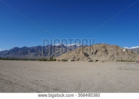 Leh Himalayan Mountains With The Blue Skyline In Leh Ladakh Capital Of Jammu & Kashmir State, North