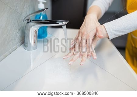 Washing Hands Under The Water Tap Or Faucet. Hygiene Concept Detail. Beautiful Hand And Water Stream