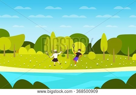 Young Couple Playing Badminton Guy Girl Wearing Medical Masks To Prevent Coronavirus Pandemic Covid-