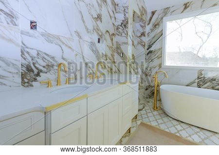 Luxury White Marble Bathroom With Washbasin Expensive Sink Antique Style With A Large Window By The