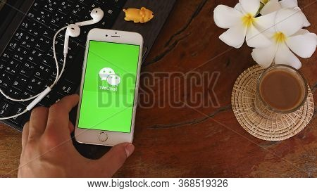 Chiang Mai, Thailand - May 22, 2020 : Man Holds Iphone 6s With Wechat App On The Screen.wechat Is A