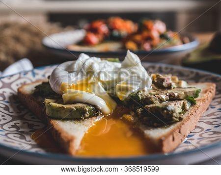 Avocado Mashed Toast And Poached Egg Healthy Breakfast. Healthy Vegan Breakfast. Fresh Green Avocado