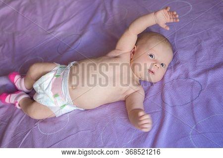 Adorable Beautiful Newborn Baby. Little Newborn Baby Girl 1 Mounth Looking In Camera. Newborn Child