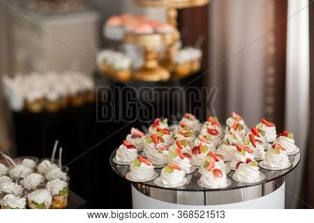 Table With Sweets, Buffet With Cupcakes, Candies. Candy Bar, A Table With Sweets And Desserts. Buffe
