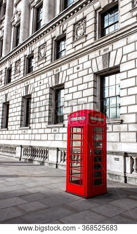 Red Phone Box In London, United Kingdom,the Back Is The Building