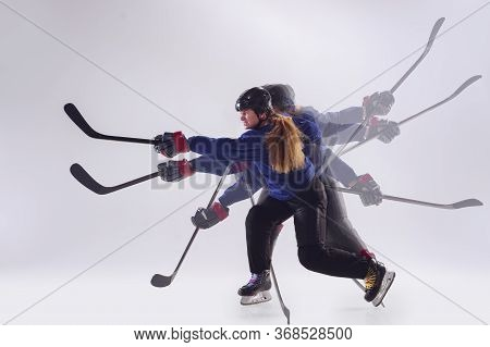 Young Female Hockey Player With The Stick On Ice Court And White Background. Sportswoman With Equipm