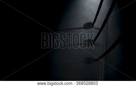 A Dramatic Closeup Of A Dimly Spotlit Corner Of A Vintage Boxing Ring Surrounded By Ropes On A Dark
