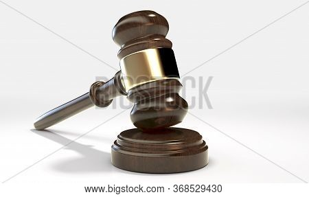 A Regular Wooden Auctioneers Hammer Or Judges Gavel With Brass Trim On An Isolated White Studio Back