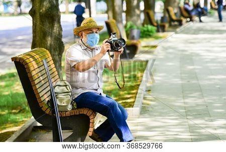 Pandemic Concept. Risky Photographer. Keep Working. Tourist Use Camera Take Photo. Urban Photography