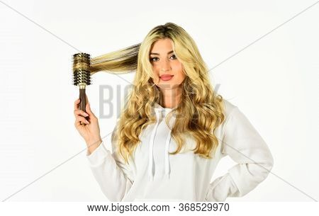 Curling Your Hair Much Easier. Hot Curling Brush. Pretty Woman Brushing Hair Isolated On White Backg