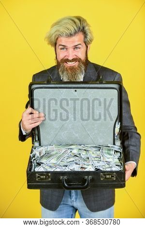 Billionaire. Live In Luxury. Bag With Dollar. Happy And Successful Man Hold Money Case. Bearded Man