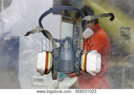 Half Mask Respirator Or Gas Mask With Antivirus Filters On A Laboratory Background With Smoke Around