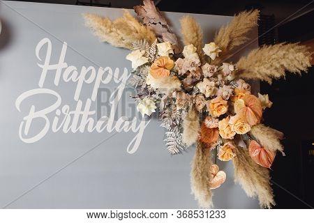Birthday Photozone With Pampass Grass And Fresh Flowers
