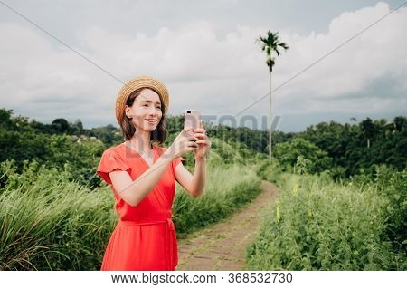 Caucasian Woman In Hat Enjoying Vacations Travel Shooting Photo Or Video For Sharing Media Content T