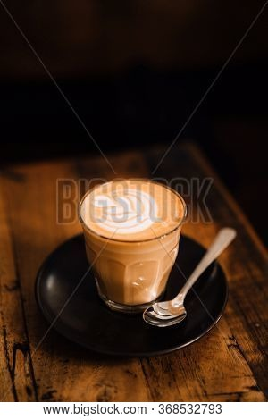 Mug Of Flat White Coffee With Latte Art On Wooden Table At The Hipster Coffee Shop. Copyspace, Low-k