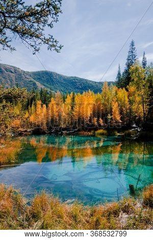 Blue Geyser Lake During Golden Autumn Season In Altai, Siberia, Russia.