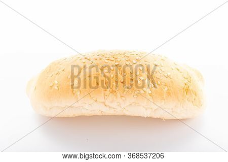Hot Dog Bun With Sesame Seeds. Sandwich Bun On A White Background.