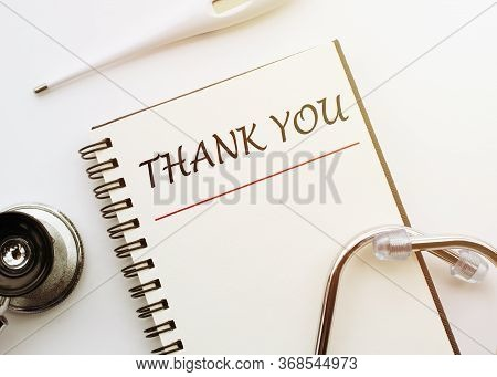 Thank You - Text On White Background With Medical Stethoscope, Thermometer. Concept Of Gratitude To
