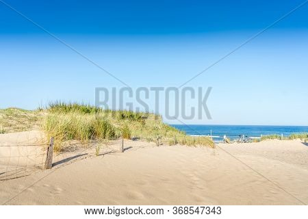Sunset Sea Sand Beach Landscape. Background Summer Sky. Top View. Natural Background. Scenic Travel