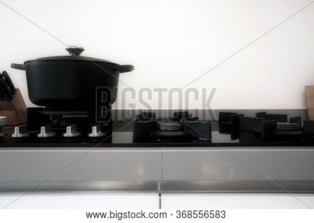 Cooking On A Gas Stove With A Black Modern Iron Casserole Pan Retro Design