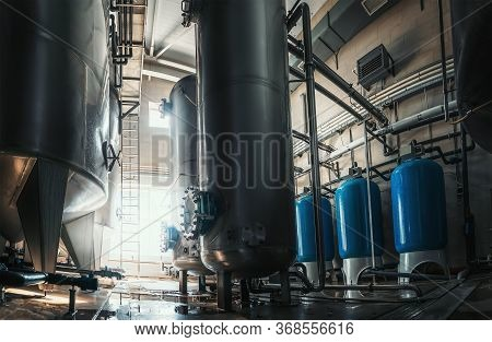 Industrial Interior Of Water Factory Production. Large Steel Tanks For Filtering And Potable Water T