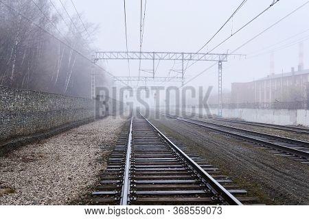Hazy Landscape - Railway Tracks Hiding In Fog In Perspective