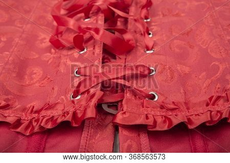 Red Women Corset On A White Background