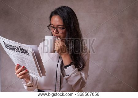 Women Reading A Newspaper
