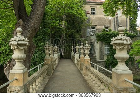 Ilowa Court Park, Historic Pedestrian Overpass.\nmanor Park In The City Of Ilowa In Western Poland.