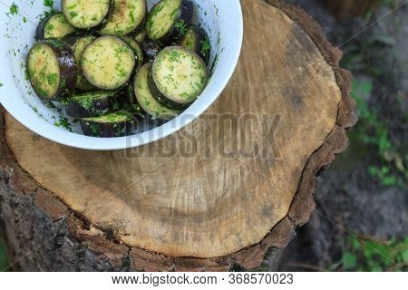 In A Bowl, Raw, Struck Eggplant In A Marinade With Herbs, Dill In A Rustic Natural Form. Preparation