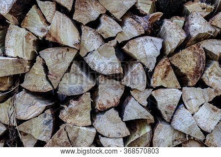 Background With Stacked Stacked Firewood. Winter Blanks For Collapse And Heating