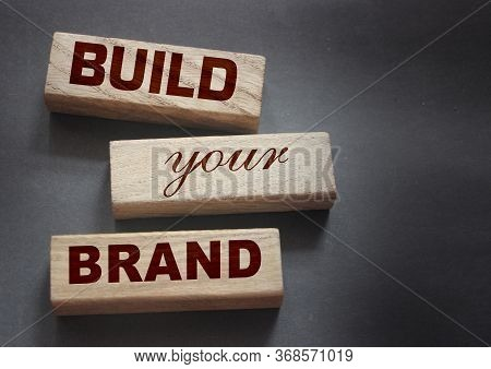 Phrase Build Your Brand Written On Wooden Blocks. With Vintage Styled Background. Branding Rebrandin