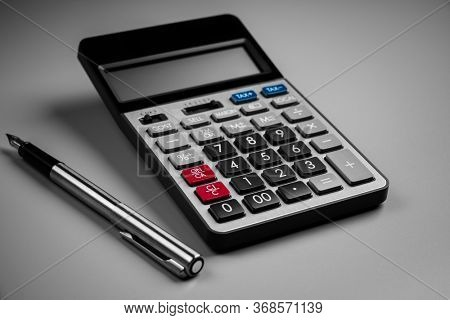 close up top view calculator, for counting and planning about lifestyle concept.