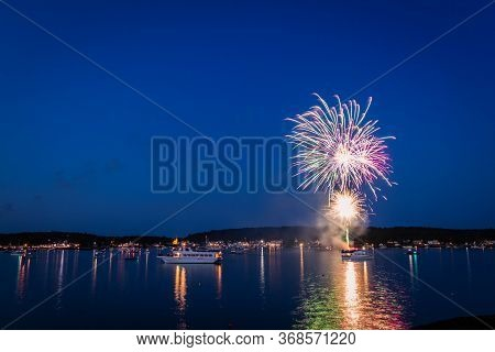 Boothbay Harbor, Maine, Usa - July 4, 2019:  Boats In The Harbor During Fireworks Display, Slow Shut