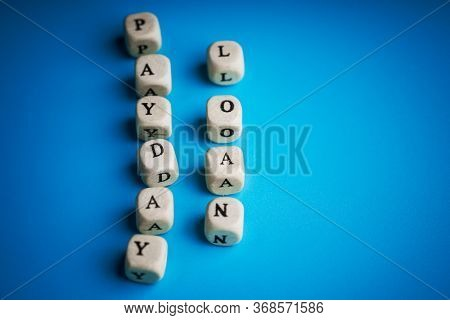 payday loan, inscription on wooden cubes.
