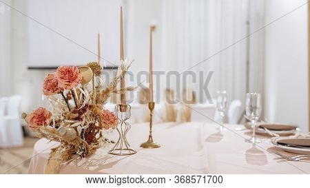 Romantic Table Setting In A Restaurant For A Holiday. Wedding Decor For Newlyweds At A Banquet. Drie