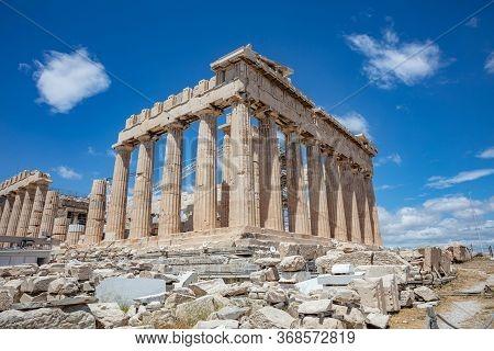 Athens, Greece. Parthenon Temple On Acropolis Hill, Blue Sky Background