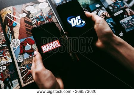 Marvel And Dc Comics Logo On The Comics Page Background.
