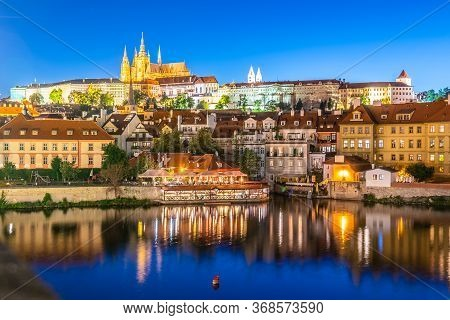 Prague Castle, Czech: Prazsky Hrad. Illuminated Landmark By Night. Vew From Charles Bridge, Praha, C
