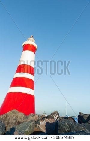 Marina Beacon Red And White Stripes Marks Entrance To Marina.