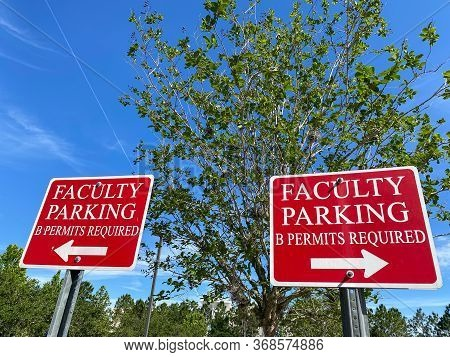 A Faculty Parking Sign In A Parking Lot Of A University Office Building Requiring B Permits.