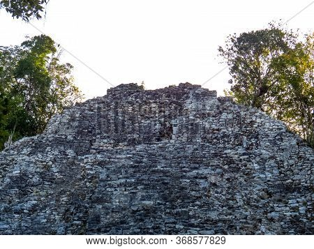 Old Ancient Stones Stacked Pyramid In The Middle Of The Tropical Forest Of Coba In Quintana Roo, Mex