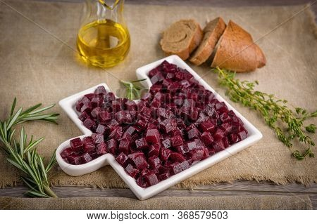 ..delicious Fresh Pieces Of Beet Cube Close-up With Fresh Onion And Olive Oil On A Bag Cloth On A Ru