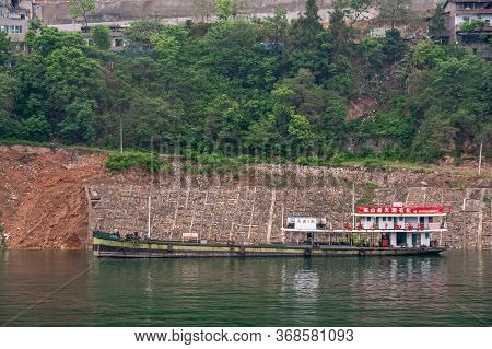 Wushan, Chongqing, China - May 7, 2010: Wu Gorge In Yangtze River. Red-white Floating Gas Station On